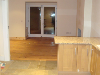 Natural stone and oak flooring
