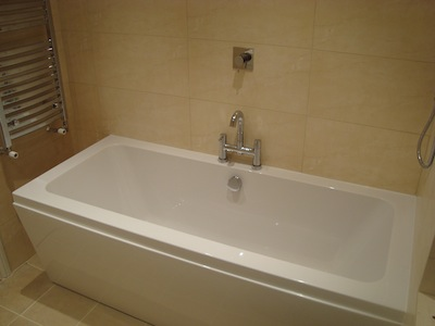 New bath with limestone tiling