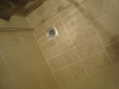 Wet room with bespoke tile design